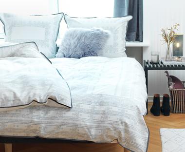 e5163aaeb Biele obliečky s etno vzorom a lemom v škandinávskom štýle