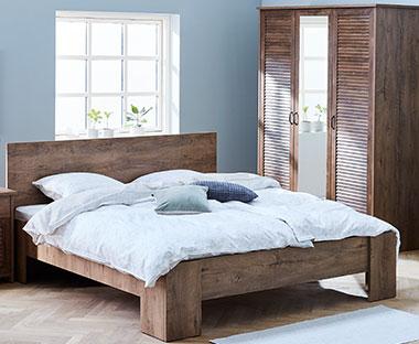 12ea0b931d0e4 Masívny posteľový rám v tmavej hnedej farbe