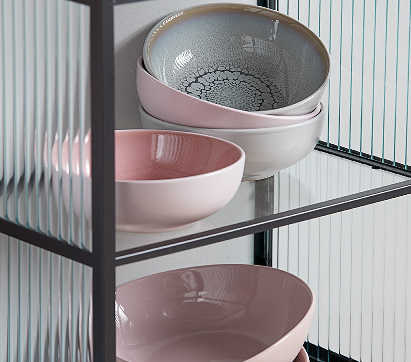 Ceramic bowls in a glass shelf