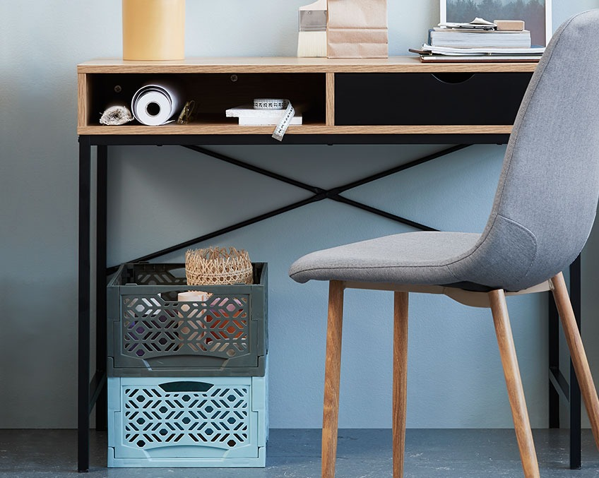 Desk with storage solutions under the table top