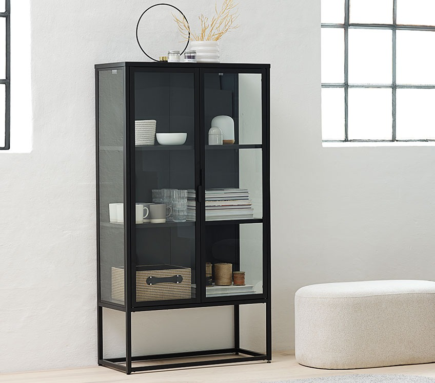 Black display cabinet with glasses, cups, books and storage baskets