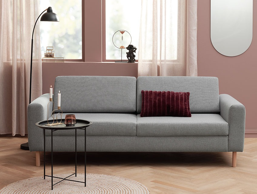 Living room with a grey fabric sofa with room for 3 people in a modern living room