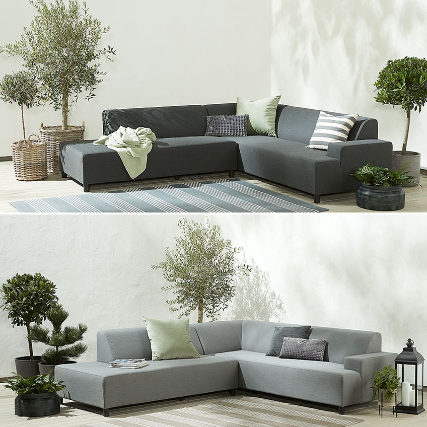 Dark and light grey garden sofa on in a corner on a patio
