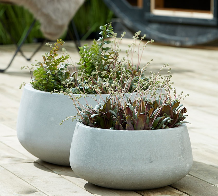 Grey garden planters on a patio